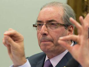 Eduardo Cunha ao lado de seu advogado, em julho.