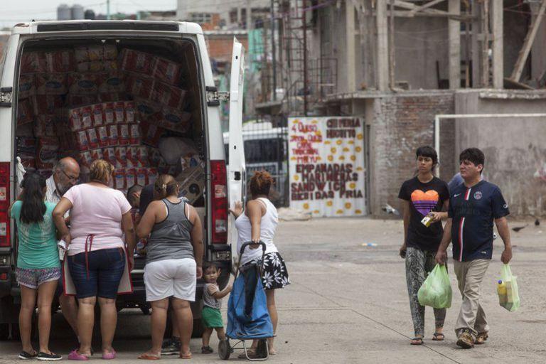 Moradores da Favela 31, no centro de Buenos Aires.