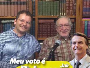 Carlos Nadalim ao lado de Olavo de Carvalho com um filtro declarando seu voto ao atual presidente Jair Bolsonaro. A foto foi retirada da página do Facebook de Nadalim.