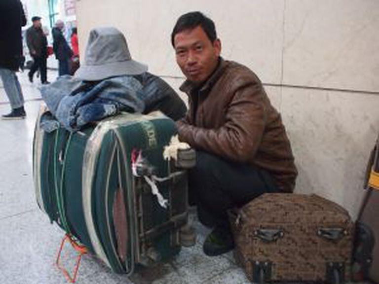 Han Husan, trabalhador itinerante de 38 anos, viajará durante seis a oito horas de trem para se reunir com a família.