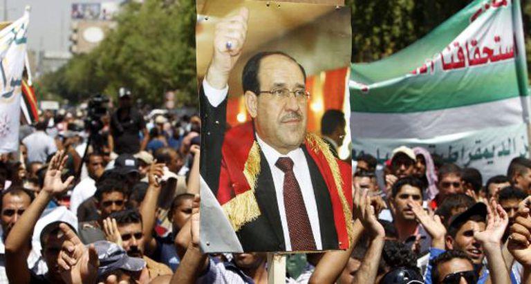 Vários manifestantes de Nuri al Maliki.