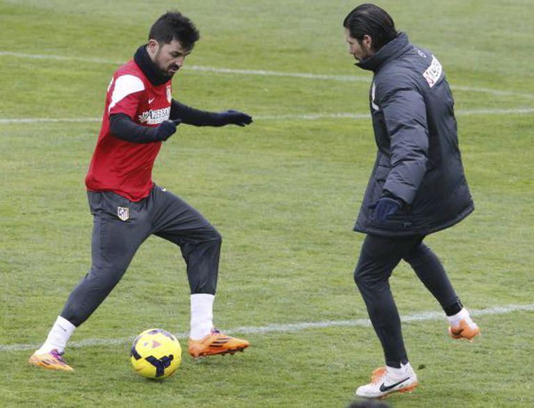 Villa e Simeone, durante um treino.