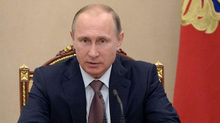 Vladimir Putin durante uma sessão do Kremlin