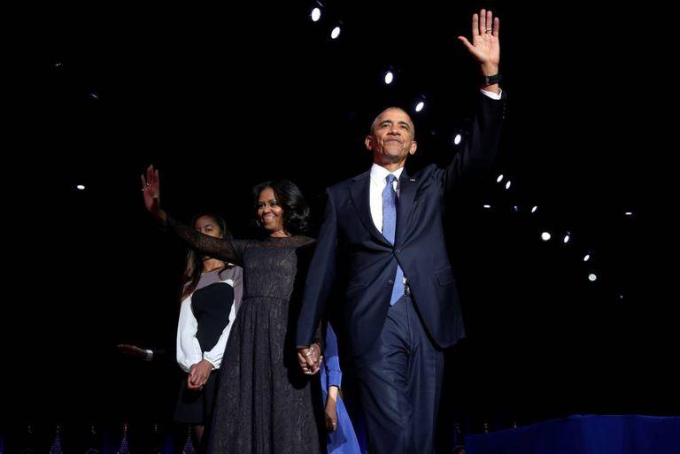 Obama junto a sua esposa Michelle e sua filha Malia.