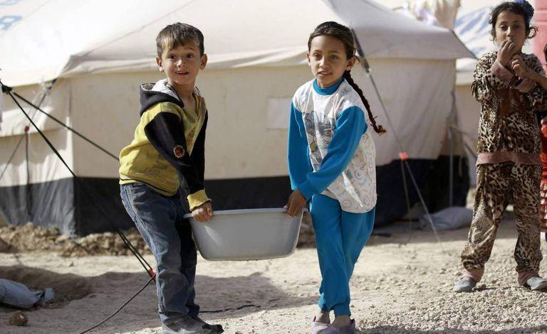 Crianças iraquianas no campo de refugiados de al-Hol, na Síria.