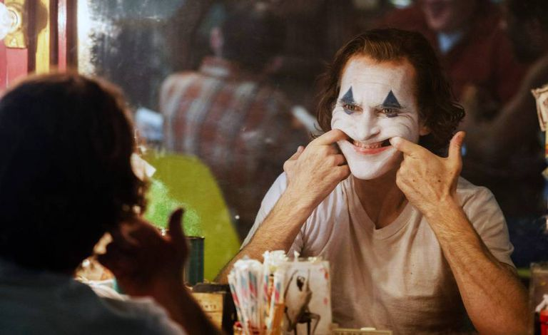 Joaquin Phoenix como Coringa.
