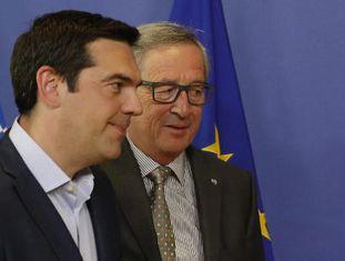 Alexis Tsipras e Jean-Claude Juncker, nesta quarta-feira em Bruxelas.