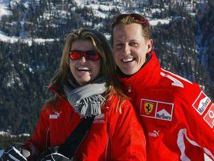 Michael Schumacher e sua esposa, Corinna, na neve.