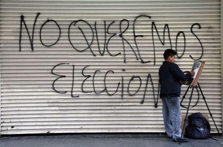 Um grafite nas ruas da Cidade da Guatemala.