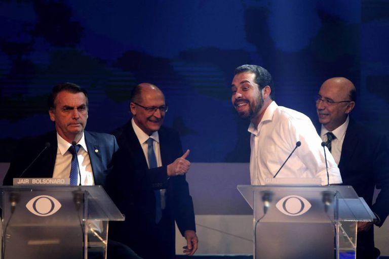Bolsonaro, Alckmin, Boulous e Meirelles durante o debate na Band