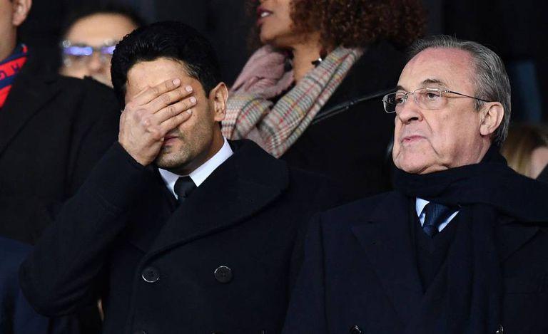 O presidente do PSG, Nasser Al-Khelaifi, cobre o rosto ao lado de Florentino Pérez.