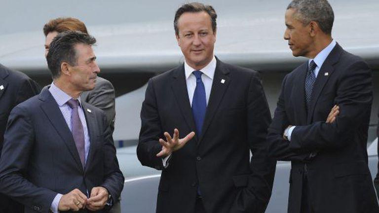 O presidente Obama, o primeiro ministro britânico Cameron e o secretário geral da OTAN, Anders Fogh Rasmussen, em Newport (País de Gales).