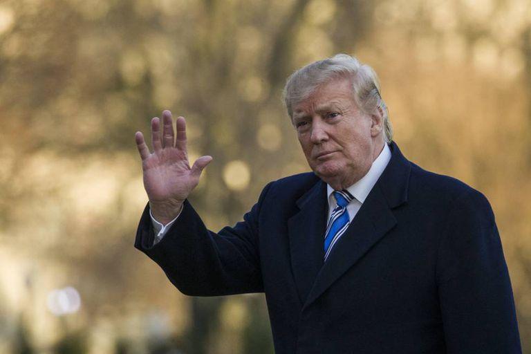 Donald Trump, ao chegar na Casa Branca no domingo.