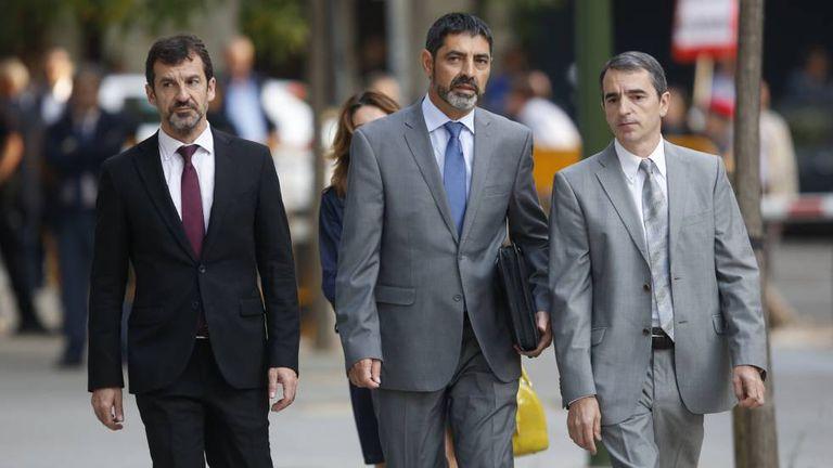 Jordi Cuixart, à esquerda, e Jordi Sánchez chegam ao Tribunal Nacional